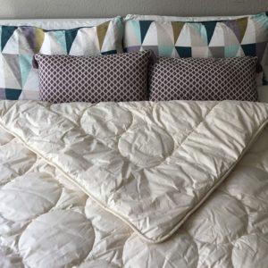 Koma schlafgut, nachhaltige Kissen udn Bettdecken für dein Schlafzimmer