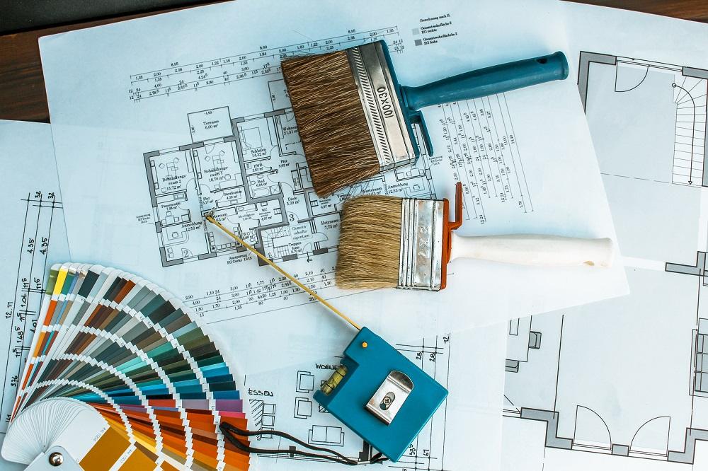 Lageplan mit Pinseln und Farben für Ferienwohnung